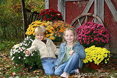 Children with fall mums