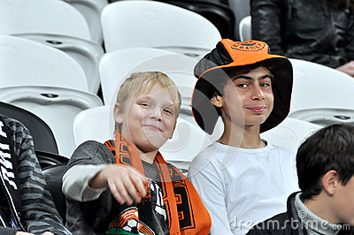 Children of the fans on the sector in anticipation Editorial Photo