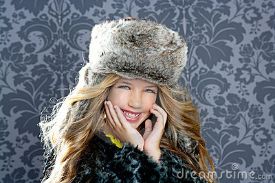 Children fashion girl with winter leopard coat