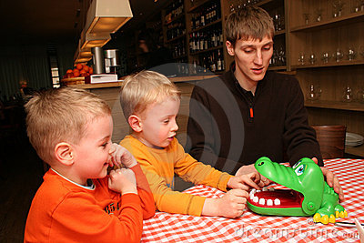 Children with father in cafe