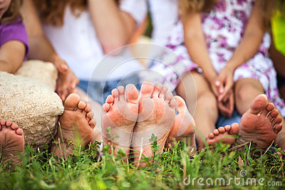 Children feet on a grass