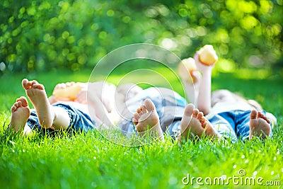 Children feet in green grass
