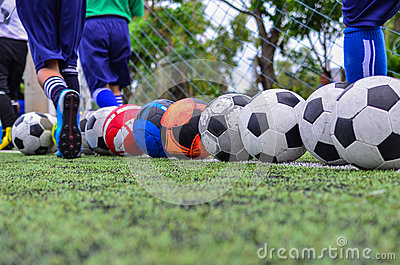 Children in football practice training