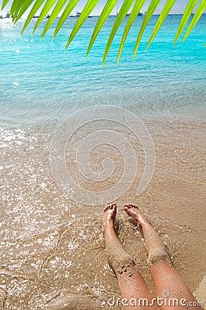 Children girl legs in beach sand shore