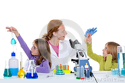 Children girlas and teacher woman at school laboratory