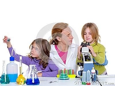 Children girlas and teacher woman at school laboratory