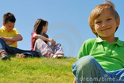 Children on a grassy hill