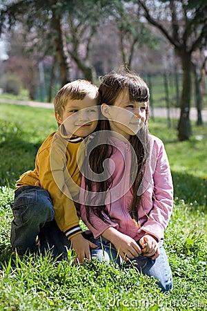 children on grassy hillside