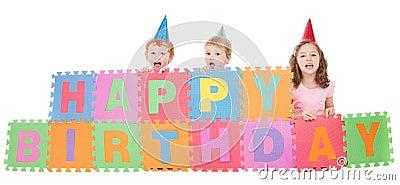 Children with happy birthday kids sign
