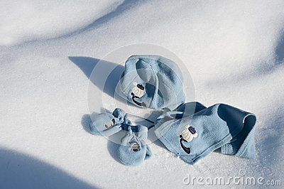 Children hat, scarf and gloves on the snow
