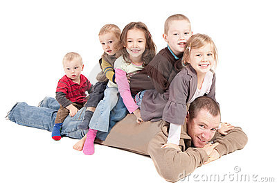 Children having fun playing with dad