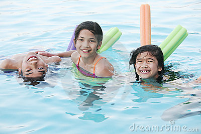 Children having fun in pool