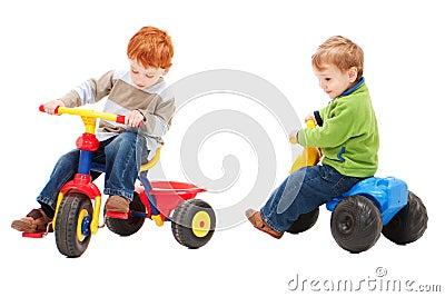 Children having fun riding on kids bikes