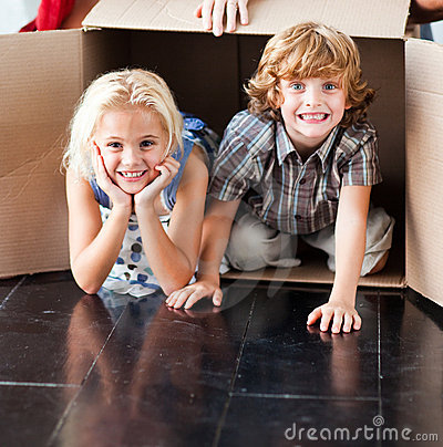 Children having fun in their new house