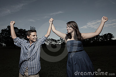 Children holding hands in the park