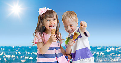 Children with icecream outdoor. Seashore in summer
