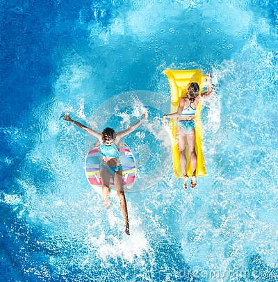 Free Children In Swimming Pool Aerial Drone View Fom Above, Happy Kids Swim On Inflatable Ring Donut And Mattress, Girls Have Fun Royalty Free Stock Photography - 133266447