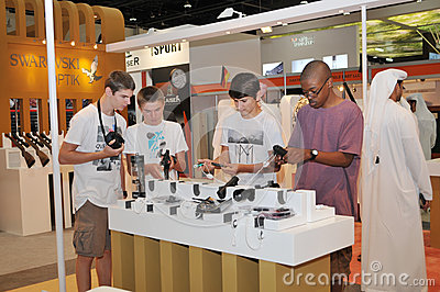 Children inspecting Gun at Abu Dhabi International Hunting and Equestrian Exhibition 2013 Editorial Photo