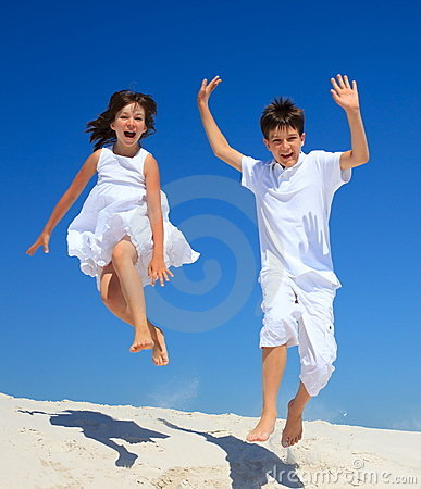 Free Children Jumping On Beach Stock Photos - 13684243