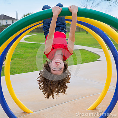 Free Children Kid Girl Upside Down On A Park Ring Stock Photography - 31371582