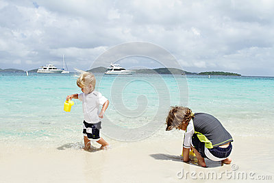 Children, kids having Fun on Tropical Beach near Ocean