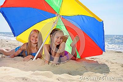 Children laying on beach