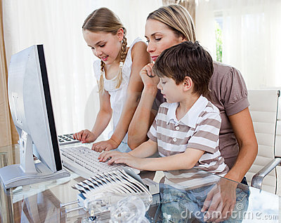 Children learning how to use a computer