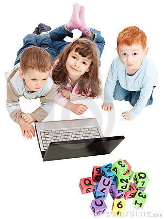 Children learning with kids blocks and computer Stock Photo