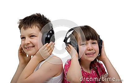 Children Listening To Music On Headphones