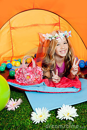 Children little girl lying in camping tent