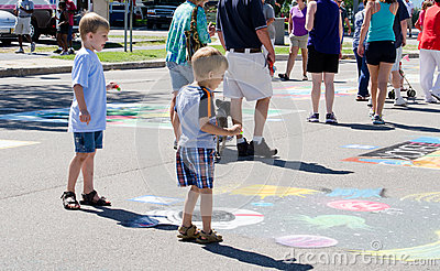 Children look at Street art Editorial Stock Photo