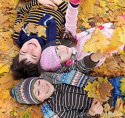 Free Children Lying In Fall Leaves Royalty Free Stock Photos - 11822148
