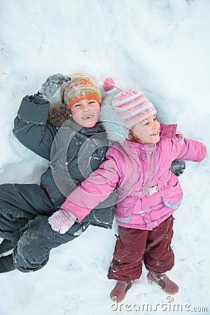 Children lying on snow