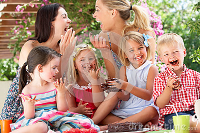 Children And Mothers At Outdoor Tea Party
