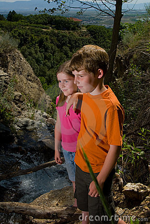 Children by a mountain stream