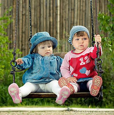 Free Children On The Swings Stock Image - 9503401