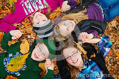 Children outdoor on autumn leaves