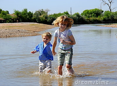 Children paddling in river