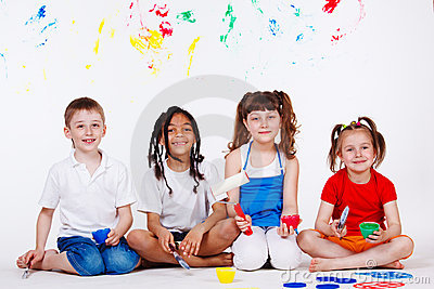 Children with paintbrushes