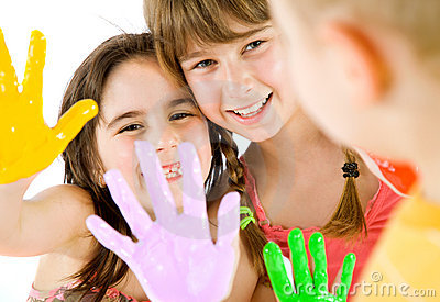 Children painted hands playing