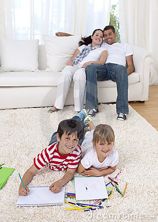 Children painting on floor in living-room