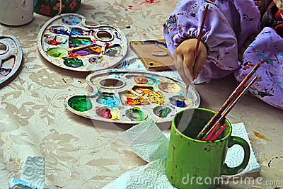 Children painting pottery 10