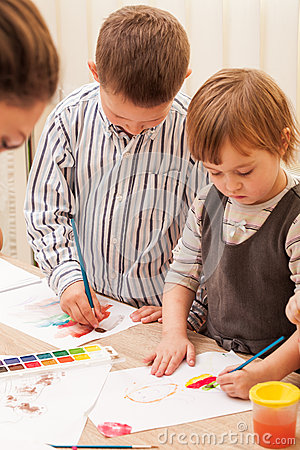 Children are painting stock photo image 64109937 for Teaching kids to paint on canvas