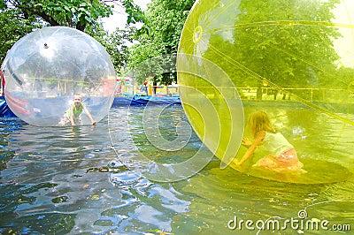 Children in park of attractions