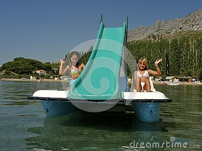 Children on pedal boat at sea