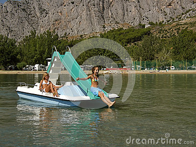 Children on pedal boat at sea 3