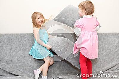 Children pillows fighting