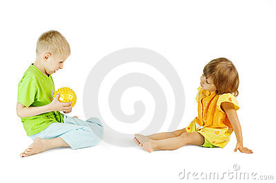 Children play with a ball