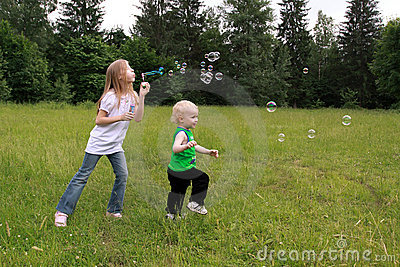 Children play with bubbles