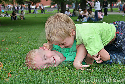Children play in grass